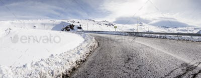 Road in ski resort of Sierra Nevada in winter, full of snow