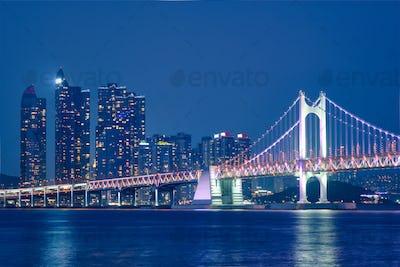 Gwangan Bridge and skyscrapers in the night. Busan, South Korea