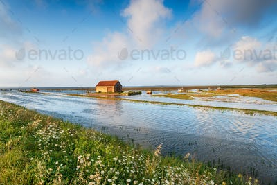 Hight tides flooding the harbour at Thornham