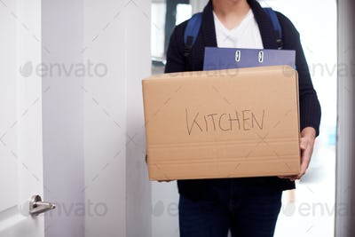 Close Up Of Male College Student Carrying Box Labeled Kitchen Moving Into Accommodation