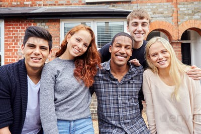 Portrait Of Group Of Smiling College Students Outside Rented Shared House