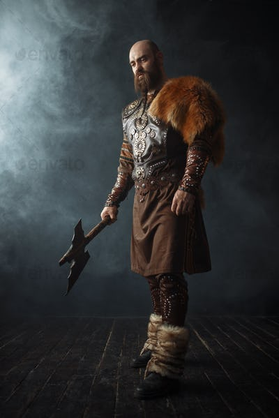Handsome viking with axe, nordic barbarian image