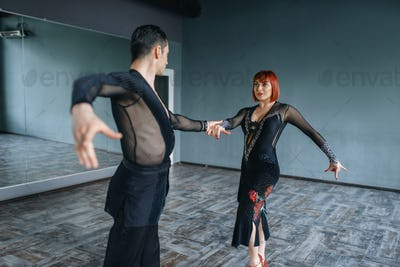 Dancers in costumes on ballrom dance training