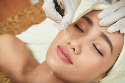 Beautician Using High Frequency Infrared Spot Remover
