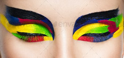 Woman's eye with vivid colors makeup