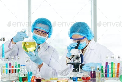 Asian Researchers Carrying out Experiment