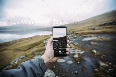 Taking picture with a smartphone  on a scenic nordic location