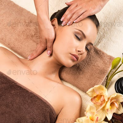 Beautiful young woman relaxing with head massage.