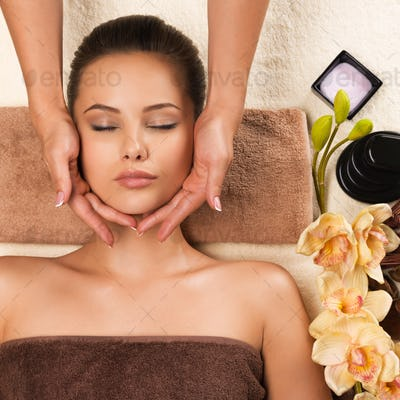 Beautiful woman relaxing and getting head massage.