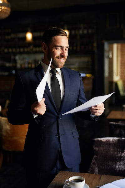 Excited businessman reading report
