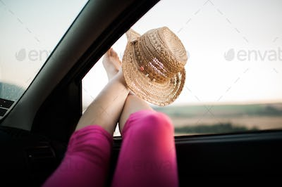 Legs sticking out of car window