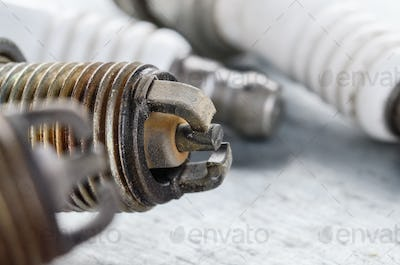 Closeup photo of old used spark plug for internal combustion eng