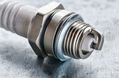 Closeup photo of new spark plug for internal combustion engine o
