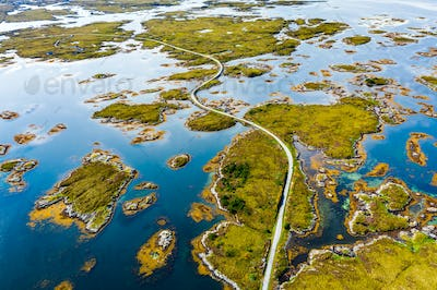 Scenic aerial view of beautiful road with bridge on the island Smola, Norway