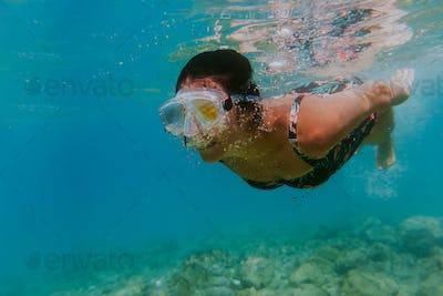 Woman swimming in sea.