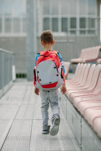 Student walking alone to a school