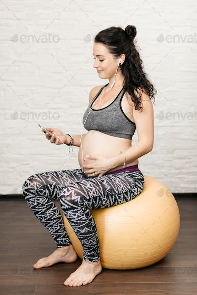 Pregnant woman listening to music.