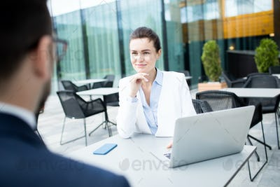 Adult businesswoman having meeting with man