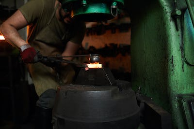 Pressing heated metal with round shaped tool