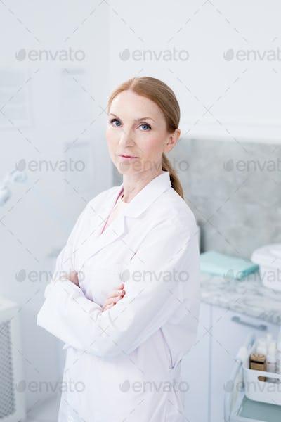 Cross-armed clinician