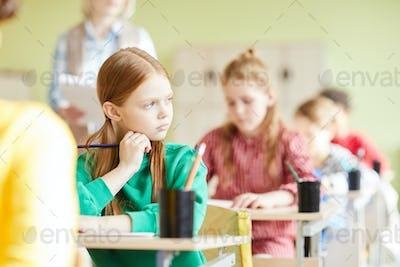 Sad student girl in classroom