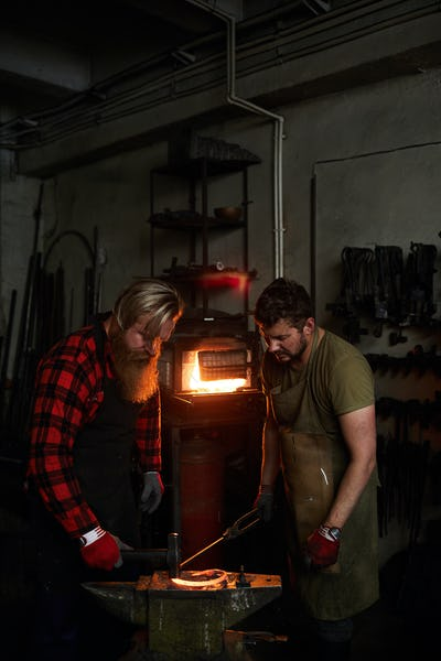 Blacksmith showing how to shape metal