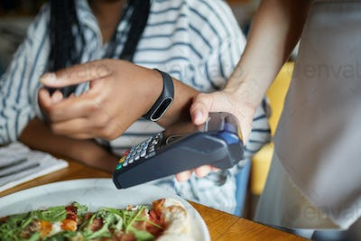 Smartwatch over payment machine