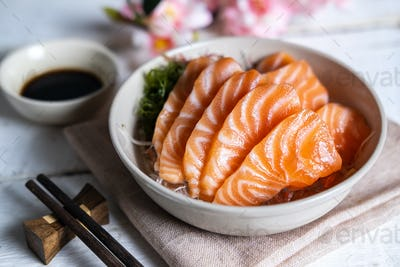 Salmon sashimi with soy sauce, raw fish in traditional Japanese style