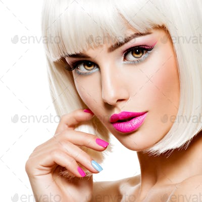 Face of a beautiful woman with pink eye make-up and multicolor n