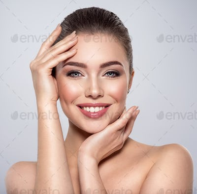 Beauty face of the young beautiful smiling woman