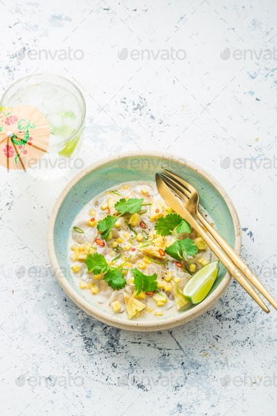 Scallops tartare with mango and pineapple in coconut milk, thai style, copy space