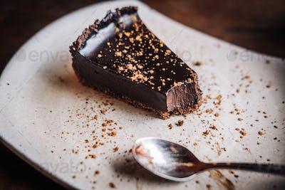 Slice of raw vegan dark chocolate cake