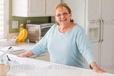 Senior Adult Woman In Kitchen