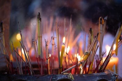 Burning incense sticks in a Buddhist Temple in Thailand.