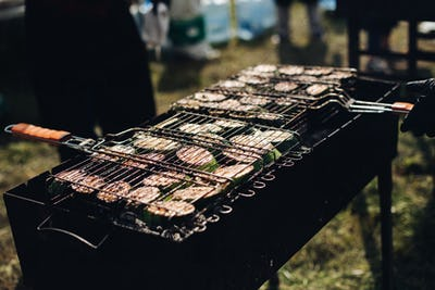 Cabbage on grill.Close-up of raw sliced squash being grilled on outdoors grill equipment
