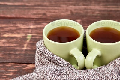 Two warm cups of tea, autumn leaves