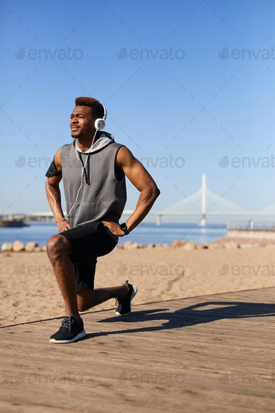 Black man training on beach