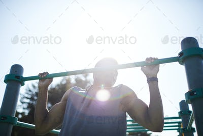 Strong black man doing workout exercise outdoors