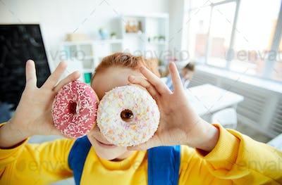 Schoolgirl with donuts
