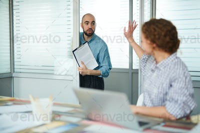 Stunned assistant with papers barging into office of manager