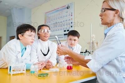 Kids at lesson of chemistry