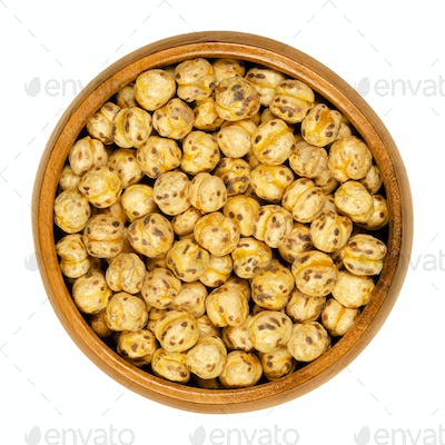 Roasted yellow chickpeas in wooden bowl