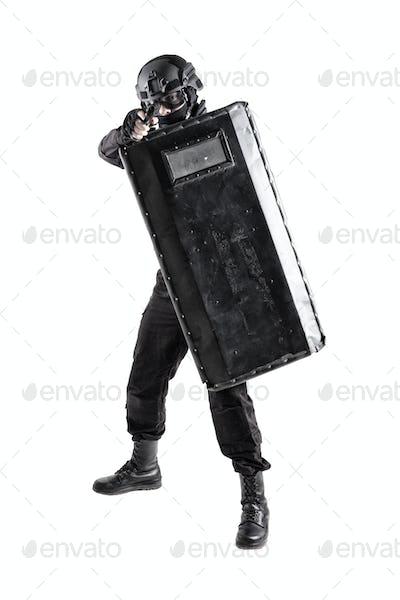 SWAT team fighter hiding behind ballistic shield