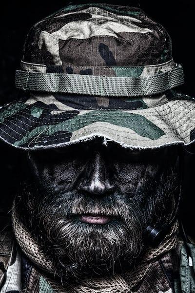 Commando soldier in boonie hat close up portrait