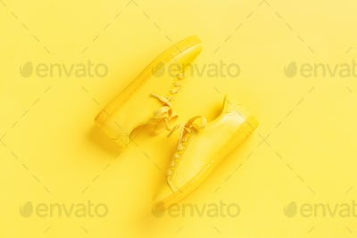 A Pair of Yellow Shoes on Yellow Background.