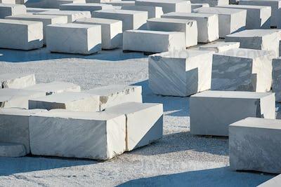 Large rectangular blocks of white Carrara marble