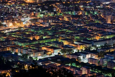 Elevated rooftop night view of La Spezia, Italy