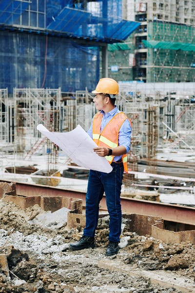 Engineer working at construction site