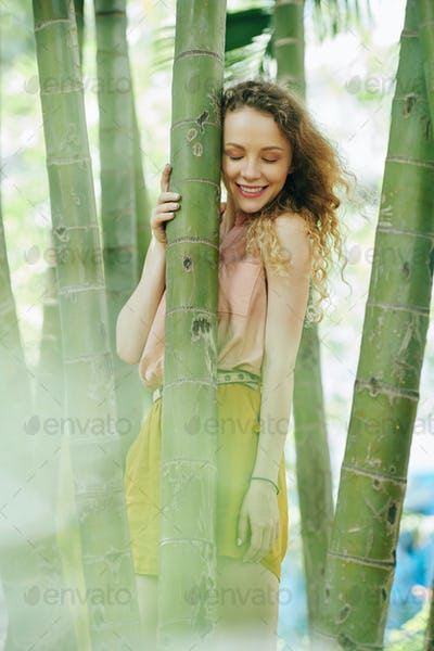 Dreamy girl in bamboo forest