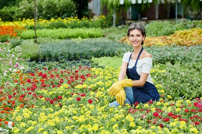 Woman spending time in her blooming garden